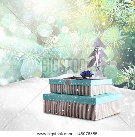 Beautiful Christmas gifts with toys on natural snowdrift