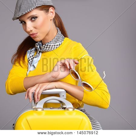Vintage woman with  yellow suitcase