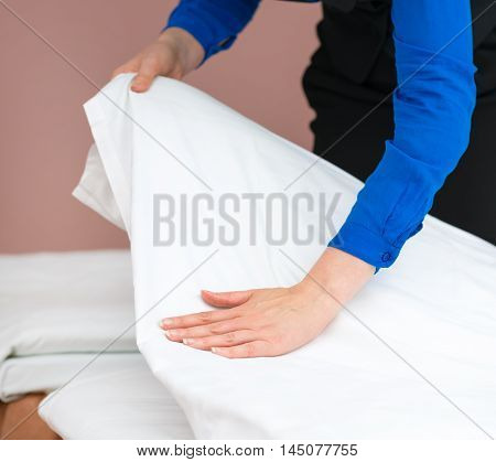 Room Service. Woman Making Bed In Hotel Room.