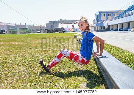 young woman doing tricep dips on a bench outdoor, fitness and sport lifestyle.