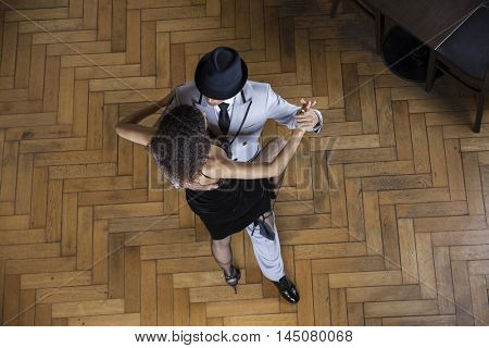 High Angle View Of Man And Woman Performing Tango