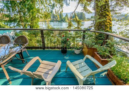 Private lake deck with chairs and table in Vancouver, Canada.