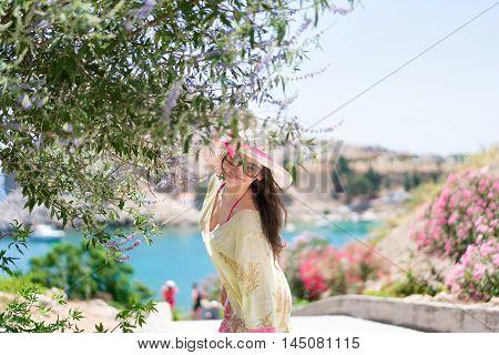 Enjoying the Greek summer. Colourful path to St Paul's bay in Rhodes island (Greece).