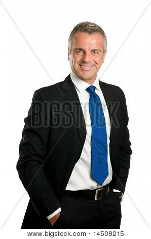 Friendly and confident mature businessman looking at camera and smiling isolated on white background