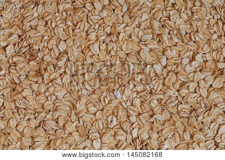 oat flakes photo, rolled oats, oat background. oatmeal photo, dry oatmeal, oatmeal grains