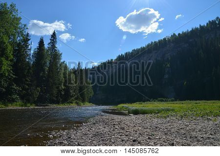 Mountain river and big rocks at background, beautiful landscape, Russia, Ural, Usva