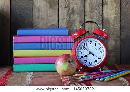 Books and an alarm clock. Back to school. September 1 knowledge Day. The teacher's day.