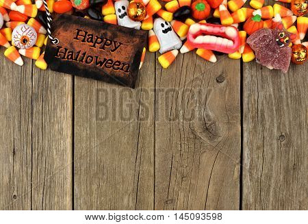 Happy Halloween Tag With Candy Top Border Against A Rustic Wood Background