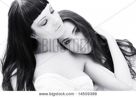 Two women lesbians in a bed.