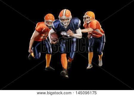 Young football players with a blue and red uniform isolated