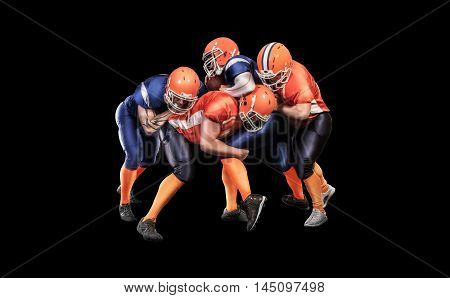 American football player with ball during competitive game isolated on black background