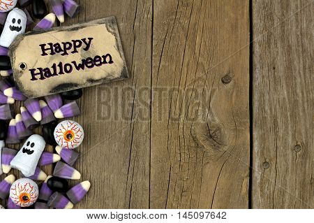 Happy Halloween Tag With Candy Side Border Against An Aged Wood Background