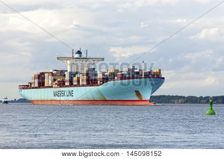 Stade, Germany - August 21, 2016: EDITH MAERSK, one of the world??s largest cargo ships, operated by maersk Line, heading towards Hamburg on Elbe river.