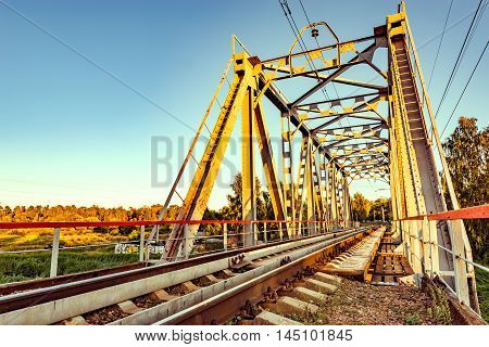 Empty railway metal bridge at early morning time.