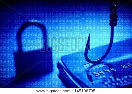Cyber crime. Credit card phishing attack. A hook and lock on credit cards
