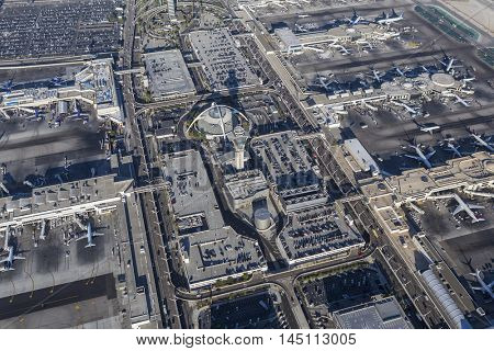 Los Angeles, California, USA - August 16, 2016:  Afternoon aerial view of LAX terminals, tower, aircraft.