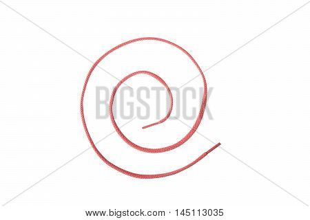 A red colored shoelace shaped into a spiral isolated on white