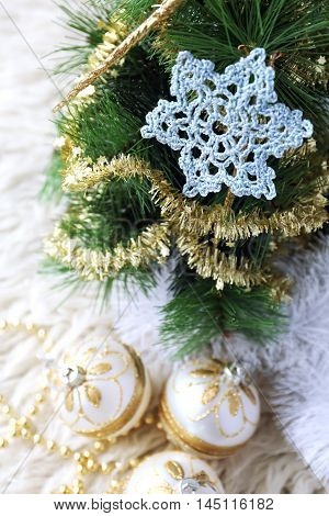 New Year composition: crochet snowflake and Christmas-tree decorations