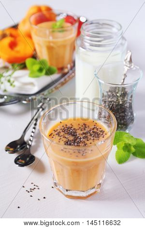 Two glasses of Apricot smoothie and chia seeds