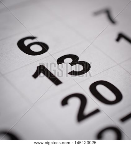 close up black white calendar thirteenth number