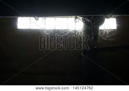 close up inside abandon manufactory with full of spider web