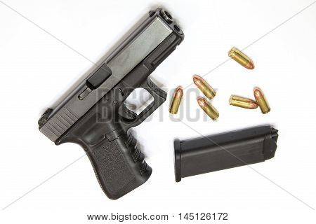 Closeup Bullets and Gun on white background