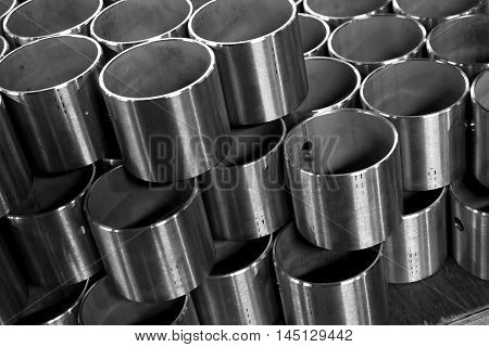 close up stack of round stainless tube in factory