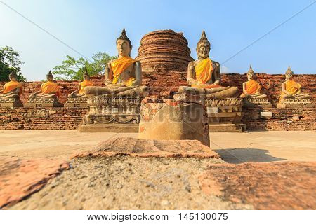 Buddha statues in AyutthayaThailand. In 1767 the city was destroyed by the Burmese army. The ruins are preserved in Ayutthaya historical park which is recognized as a UNESCO World Heritage Site.