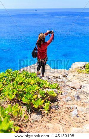 Asia woman take a photo at view point similan island Koh Ta Chai Andaman Sea Thailand
