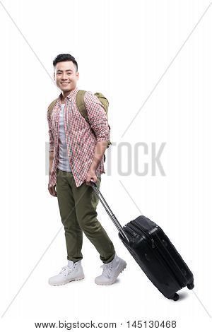 Full portrait of smiling happy man with grey suitcase - isolated on white
