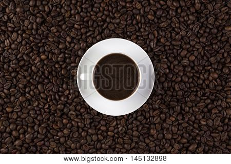 A Cup of cofee with cofee beans