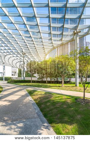 beautiful park and glass canopy at a sunny day