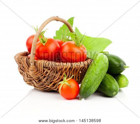 fresh red tomatoes and cucumber isolated on white