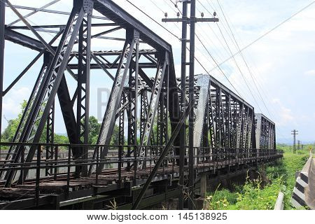 The Old railway bridge in Thailand on background