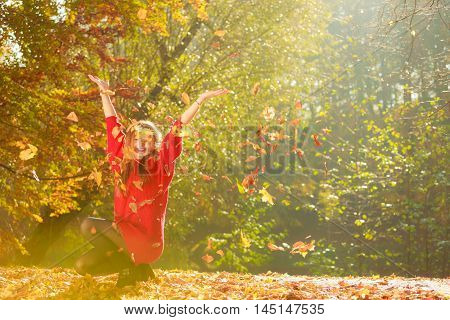 Crouching Girl In Autumnal Forest.