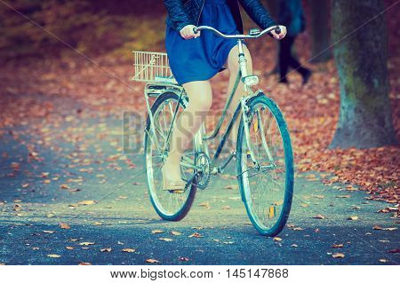 Girl In Dress On Bike.