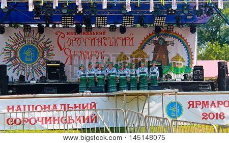 Velyki Sorochyntsi, Ukraine  -August 20 2016: National musical group acts on Sorochintsy Fair in Velyki Sorochyntsi Ukraine