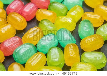 Mixed Colorful Fruit Hard Candies As Background