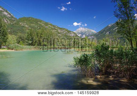 View of a water pond near the lake of Cavazzo in Friuli Venezia Giulia, Italy