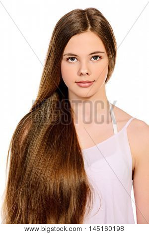 Cute girl with beautiful healthy long hair smiling at camera. Healthy hair, haircare. Isolated over white background.