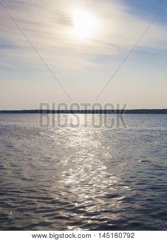 Sun reflecting on the water on a lake in Saskatchewan Canada