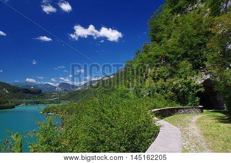 Quiet road with panorama on the lake of Cavazzo in Friuli Venezia Giulia, Italy
