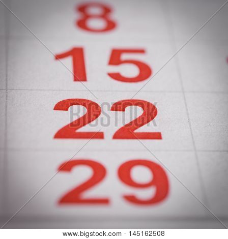 close up red white calendar twenty two number