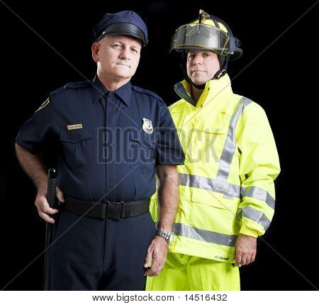 Police officer and firefighter, serious expressions, against a black background.