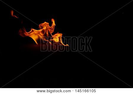 Fire flames on a black for background