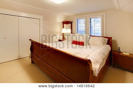 Small Bedroom With Large Brown Bed