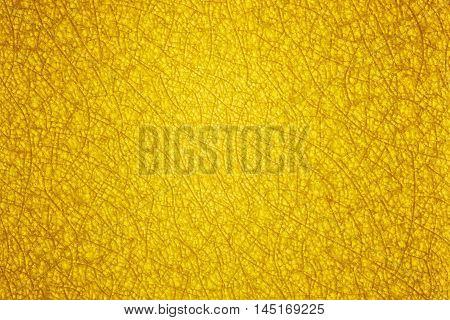 An abstract yellow gold background with a pattern of glass cracked. Can be used as a wallpaper.