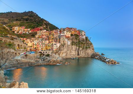 Manarola town on the coast of Ligurian Sea at dusk, Italy