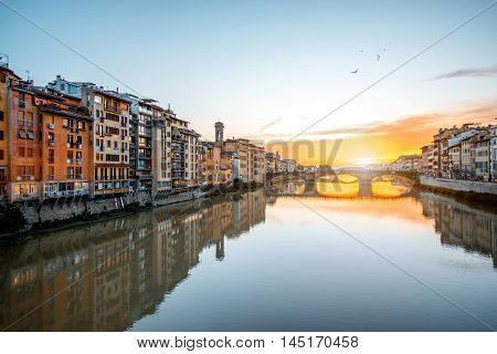 Cityscape view on Arno river with famous Holy Trinity bridge on the sunset in Florence