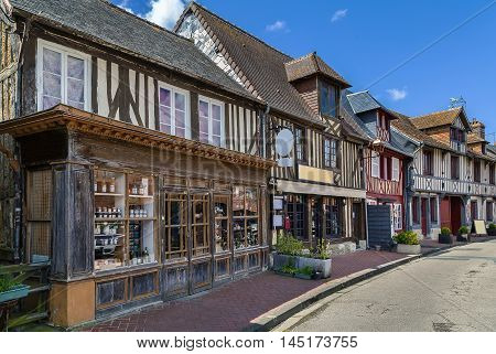street with historical half-timbered houses in Beuvron-en-Auge France